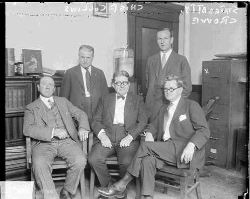 Captain Morgan Collins of Chicago Police Department and Robert E. Crowe, Cook County State's Attorney, sitting with three other me